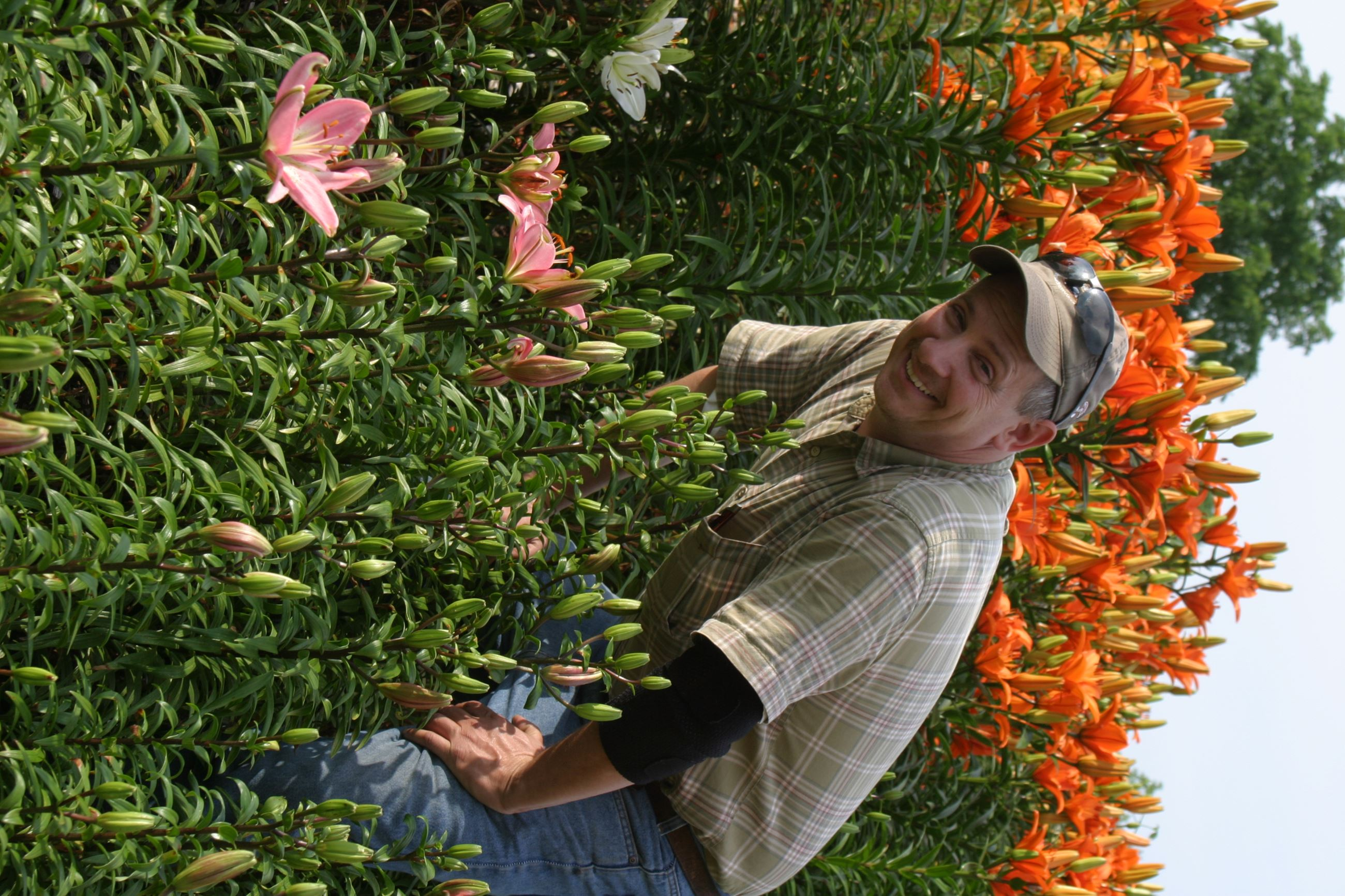 Man Standing in the Flowers